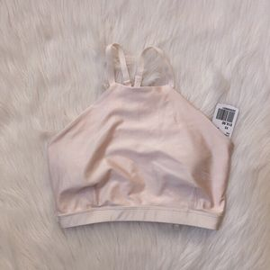 Soft light pink sports bra